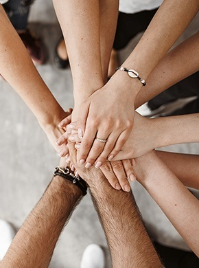 Group of people with hands stacked together