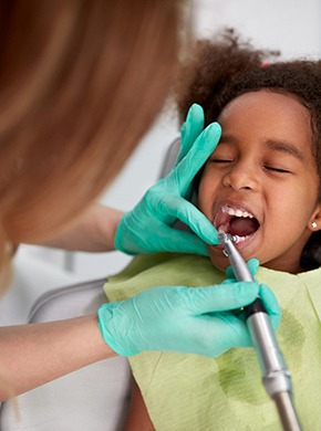child having their teeth cleaned by a dentist in Manchester