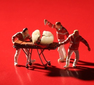 little figurines repairing a broken tooth