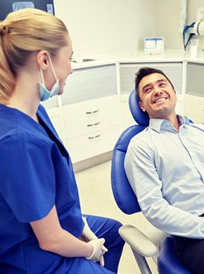 man in dress shirt smiling at his dentist